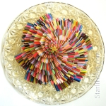 Leo Jean's Starlike© Infinity; large multi-layered colorful paper sculpture on round crystal base